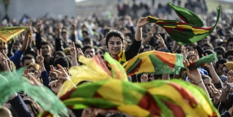 Kurdish people attend a celebration rally near the Turkish-Syrian border at Suruc, in Sanliurfa province on January 27, 2015. Kurdish fighters have expelled Islamic State group militants from the Syrian border town of Kobane, a monitor and spokesman said today, dealing a key symbolic blow to the jihadists' ambitions. AFP PHOTO/BULENT KILIC (Photo credit should read BULENT KILIC/AFP/Getty Images)
