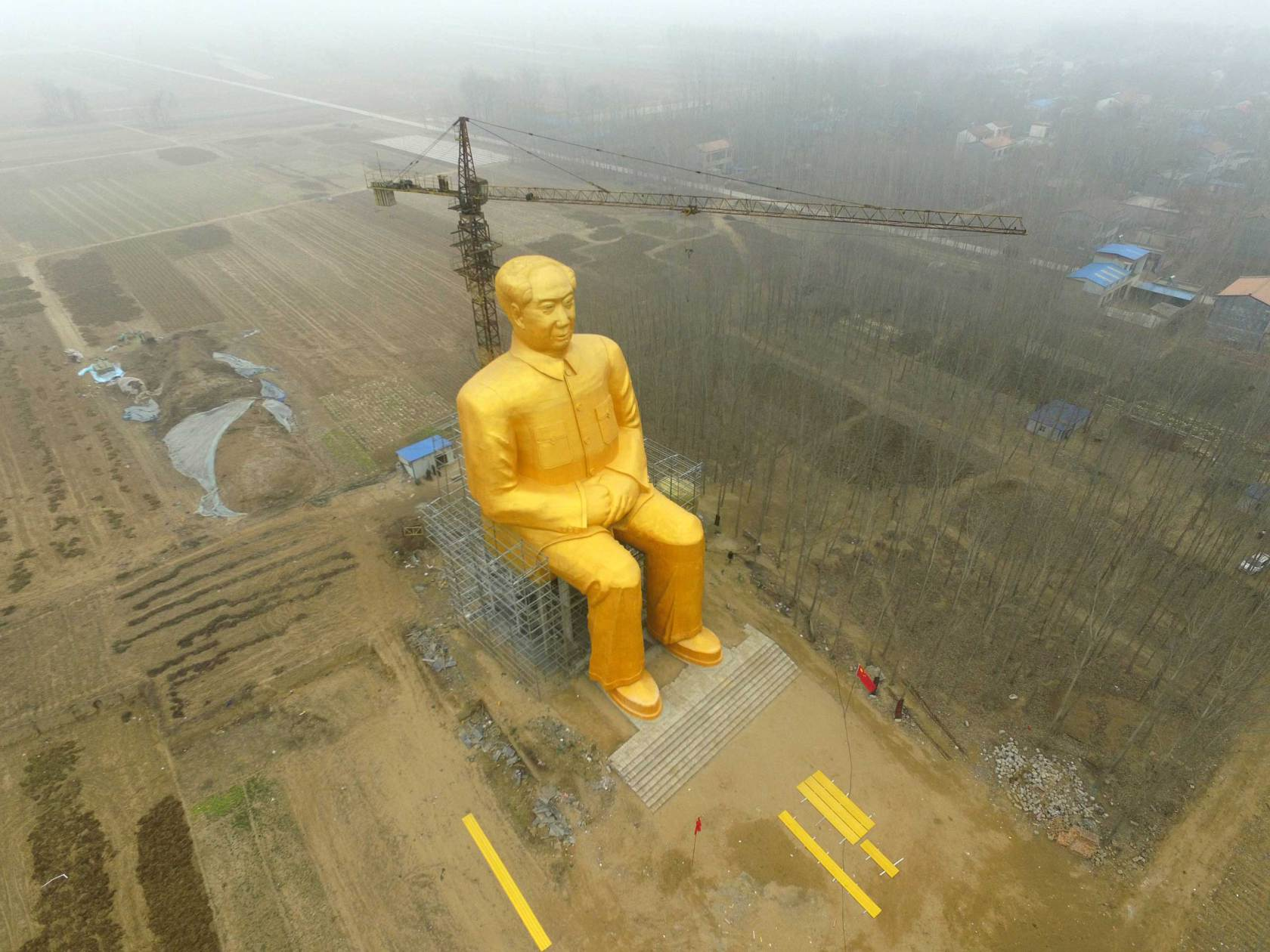 A huge statue of Chairman Mao Zedong, 36.6 meters in height, is seen under construction at Zhushigang village in Tongxu County, China, on Jan. 4. (ChinaFotoPress via Getty Images)
